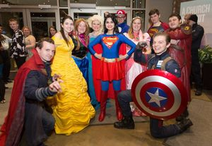 students visiting hospital or school as superheroes