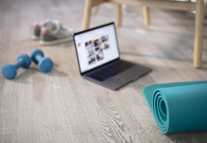yoga mat, online fitness class, and dumbbells