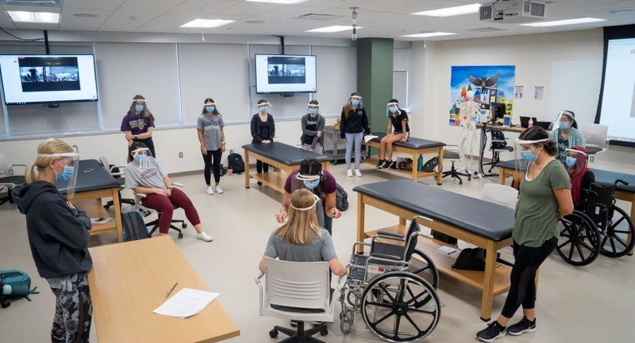 students use safe practices and social distancing during occupational therapy class