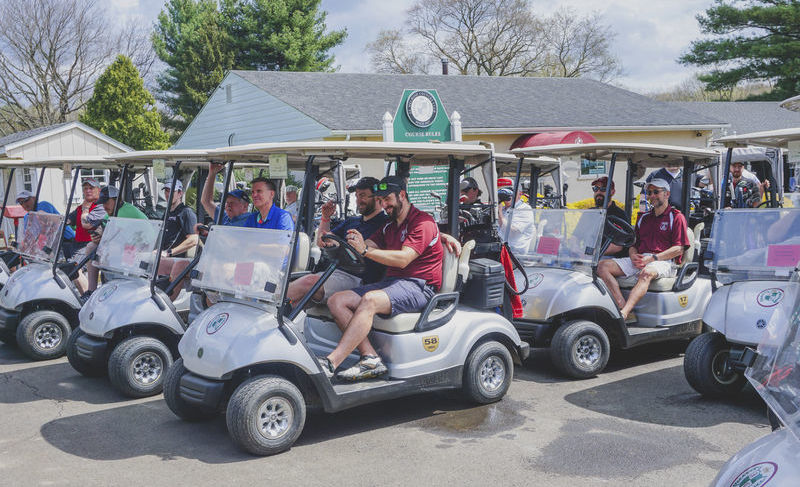 Group of participants riding golf carts
