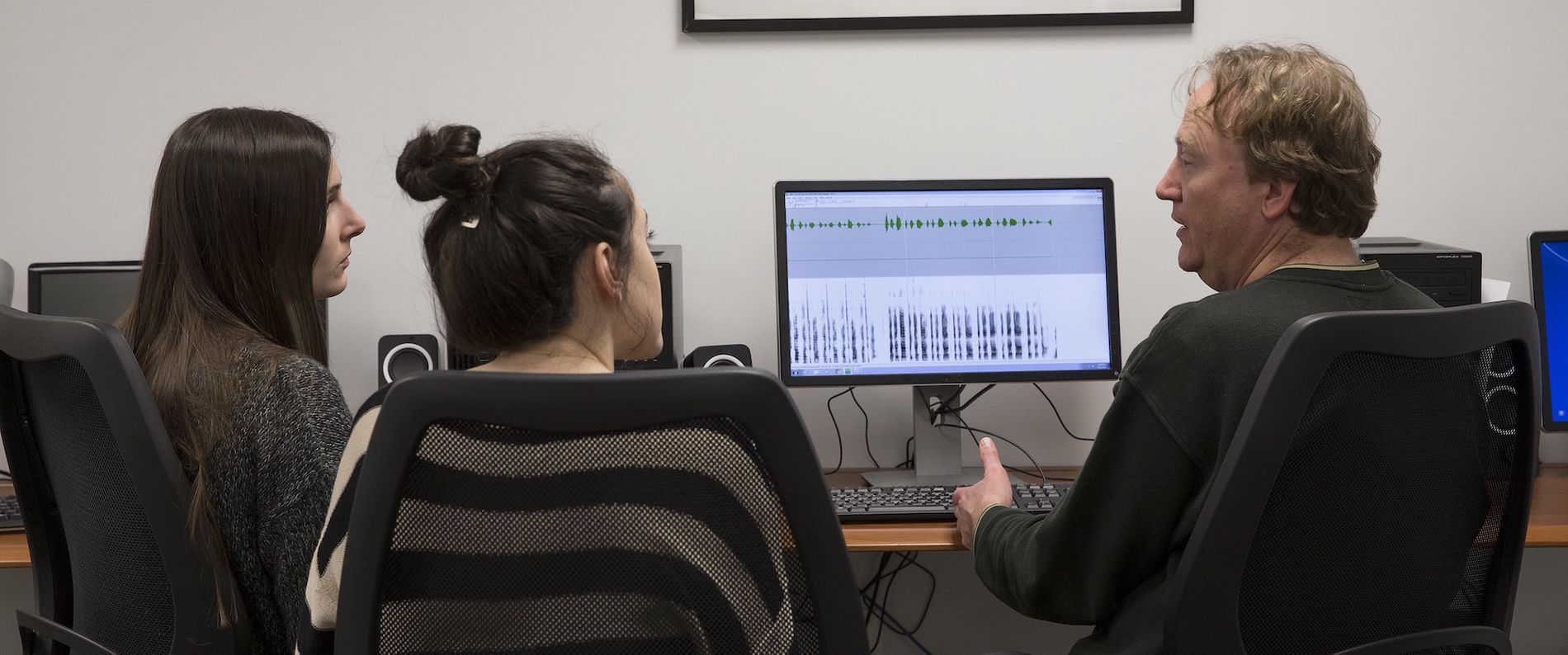 Students examine sound waves on computer screen