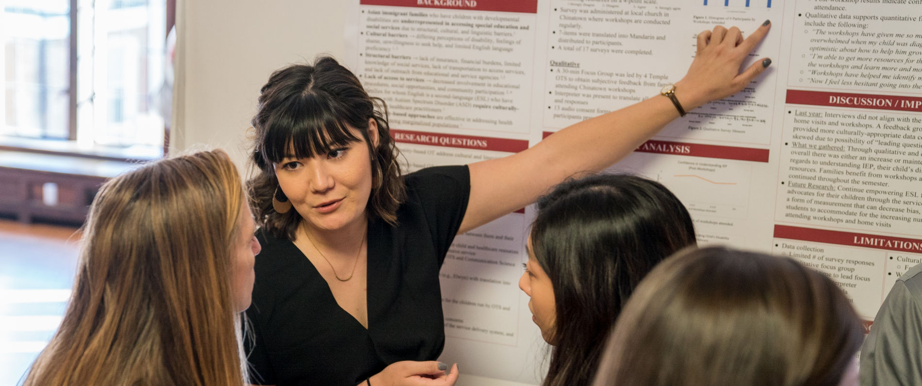Girl pointing at a research poster