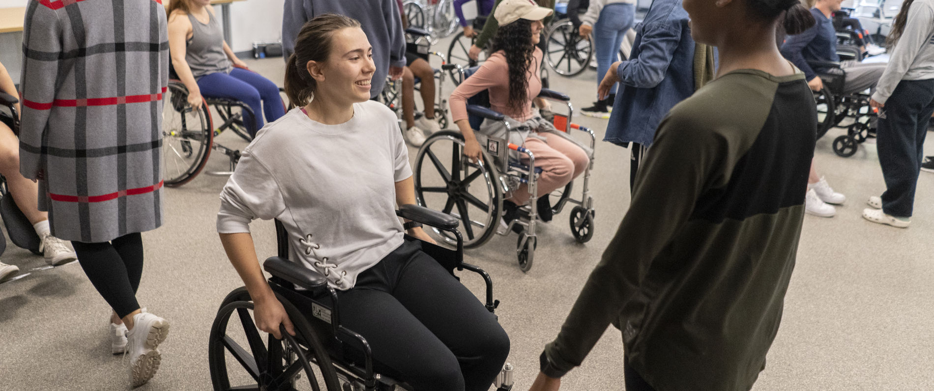 Students in a wheelchair dancing workshop