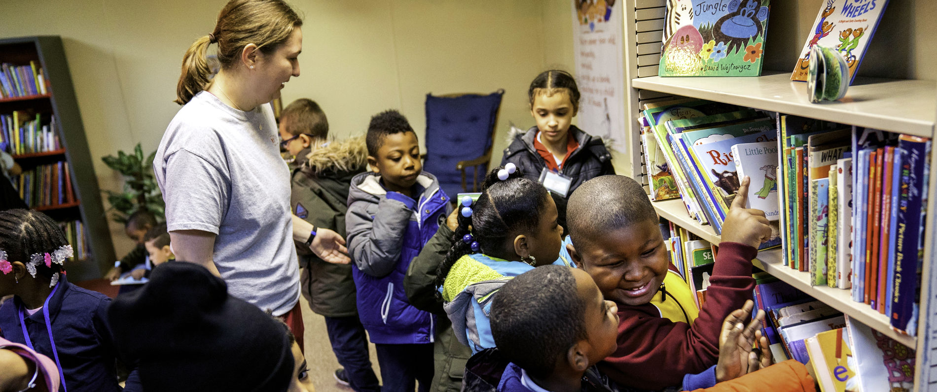 Children choosing books at a library