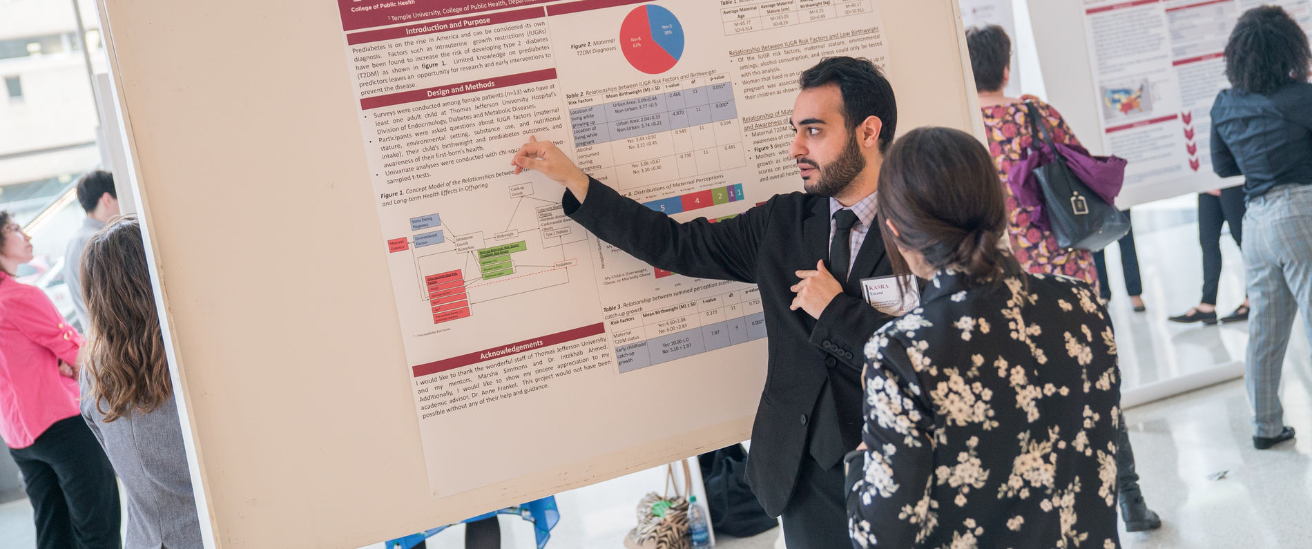 Man presenting his research poster
