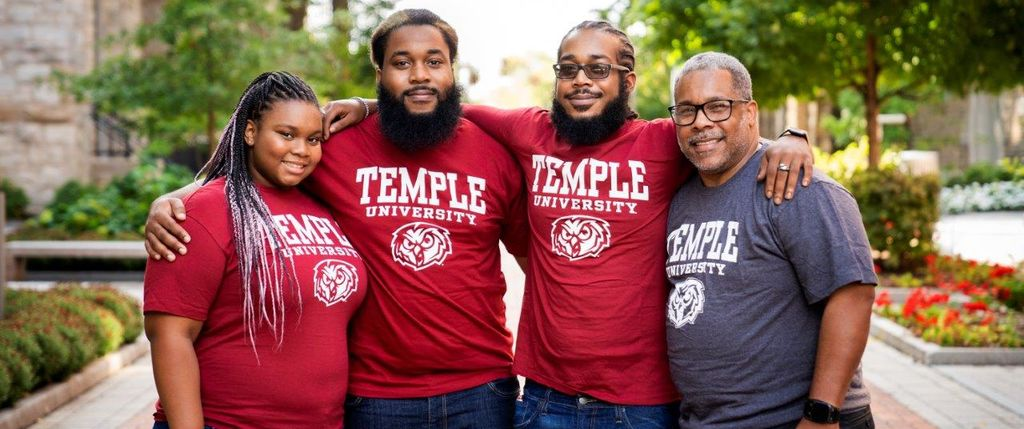 Lovell Harmon and his children on the temple campus
