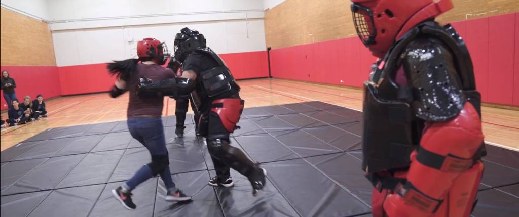 a student striking an instructor in the personal defense class