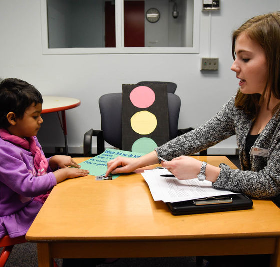 Speech pathologist working with small child