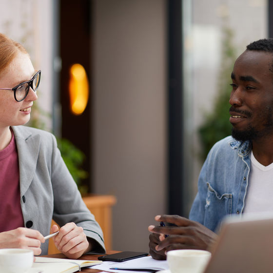 a lawyer sits at a table with a client