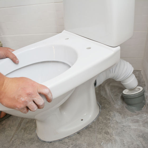 person installing toilet